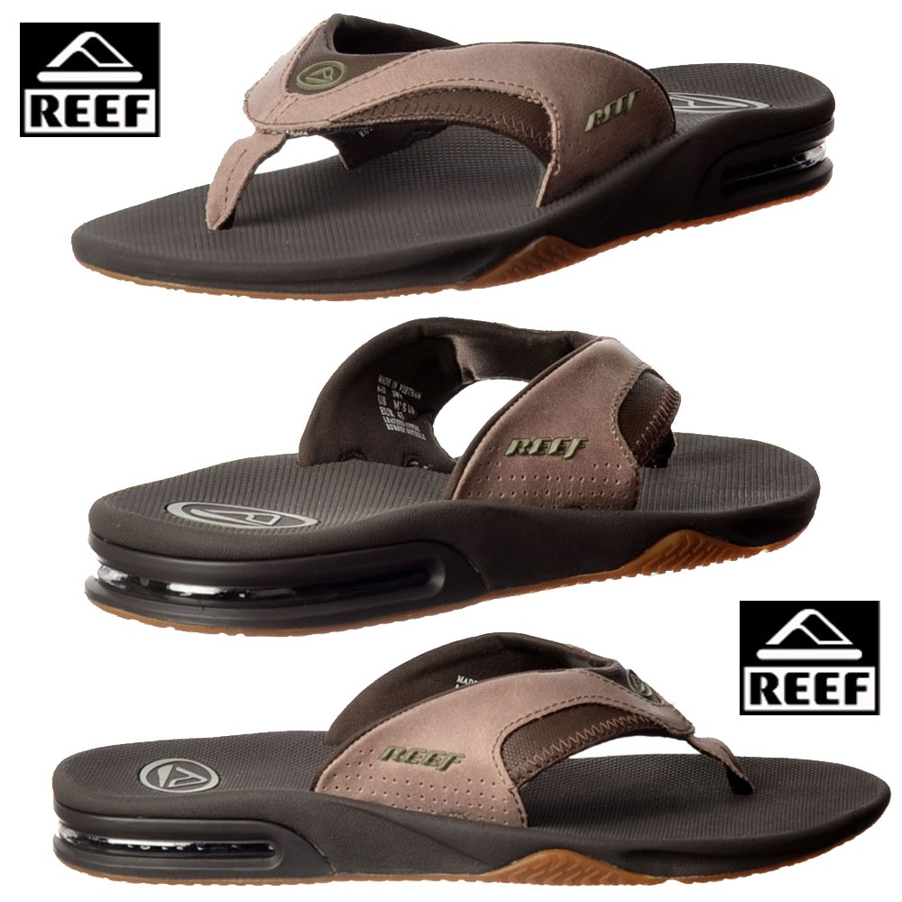 32178f5161bd7e Mens Reef Fanning TX Flat Flip Flops With Bottle Opener - Black   Dark Grey